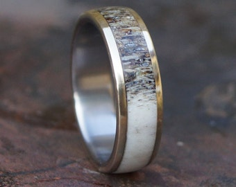Titanium and brass ring with natural deer antler inlay