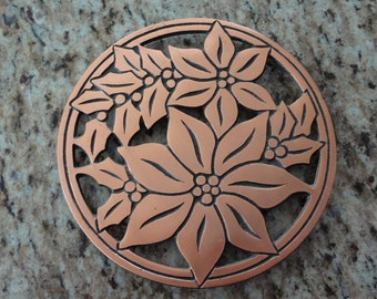 Vintage brass hot pad/wall hanging; poinsettias