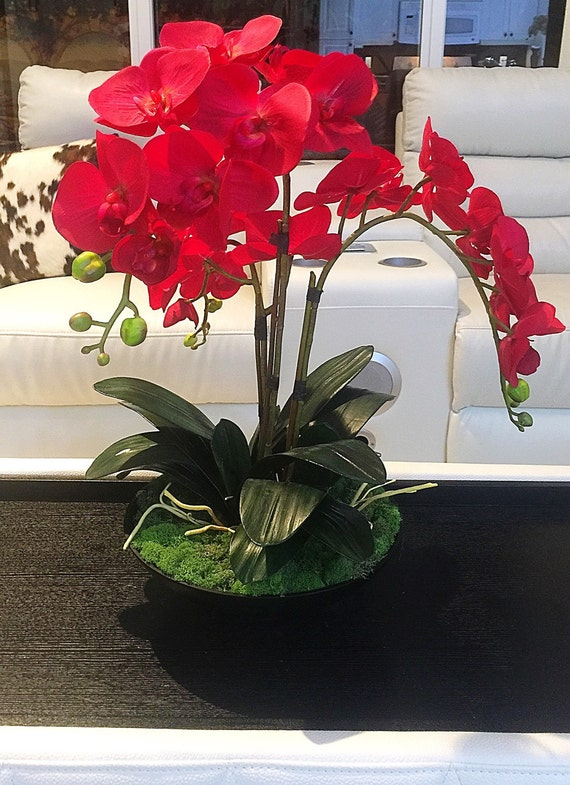 Red orchid arrangement and black centerpiece by