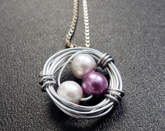 Handmade White-Purple Bead Bird Nest Pendant