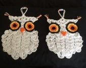 A pair of crocheted owl pot holders