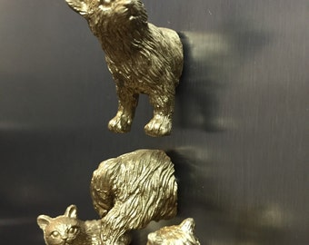 Gold cat magnets
