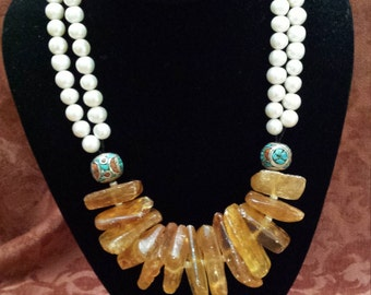 Two strand fresh water pearl necklace with large amber center