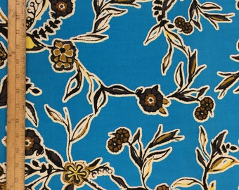 100% Rayon challis. Brown flowers. Blue background. Fabric by the yard.