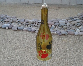 Wine bottle wind chime is unique yard art with painted dog paws. This bottle chime is a dog lovers gift, Personalize the bone with a name.