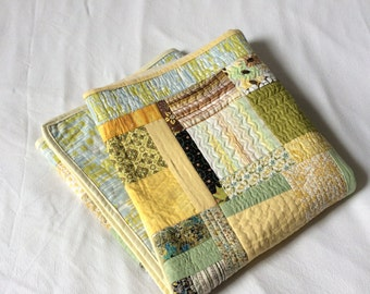 Gorgeous greens and yellow patchwork quilt