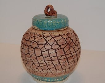 Pottery jar. Lidded pottery jar.