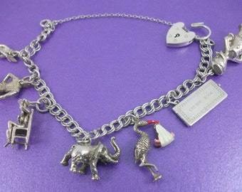 Vintage Silver Charm Bracelet, Heart Clasp, Vintage Gift, Circa 1970, Safety Chain, Seven Charms