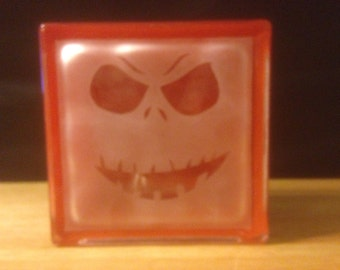 Halloween pumpkin face glass block