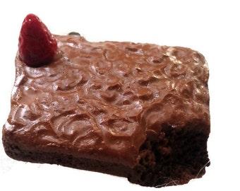 Brownie charm with a Strawberry