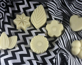 Solid Lotion Bar... great for massages, elbows, knees, and heels. Made with shea butter, coconut oil, bees wax, essential oils