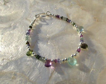 gemstone bracelet with moss and green aquamarine tourmaline tanzanite amethyst and sterling silver