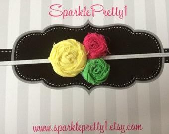 Hot pink, yellow, and green Rosette elastic headband.