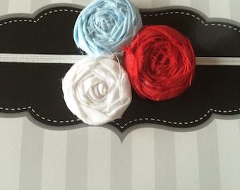 Red, white, and light blue rosette elastic headband