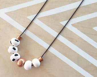 Polymer clay bead necklace. Black, copper, white 'the cleo'