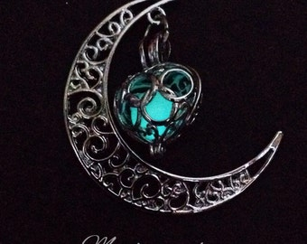 Pretty moon and heart glow in the dark pendant