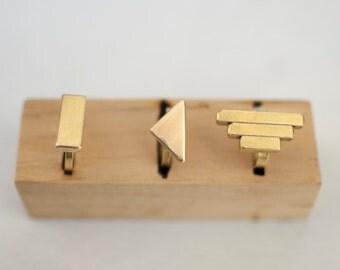 Geometric brass rings