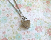 Cremation urn necklace.  Small heart shaped urn for loved ones ashes.  Hand stamped, personalized, customizable.  Stainless steel.