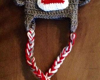 Crocheted sock monkey hat with ear flaps