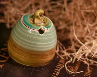 Honey pot or sugar bowl with an olive green and celadon glaze