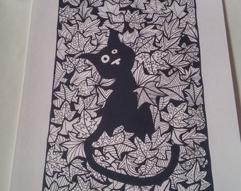 Black cat hiding among the leaves A4 print.