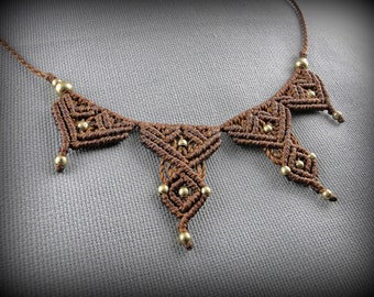 Brown macrame necklace adorned with brass beads. For every styles, day or night!