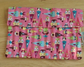Salmon Pink gnomes & fairies pencil roll containing 12 pencils