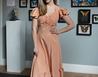 1930s dress with bakelite or lucite buttons