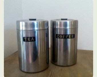 Mid Century stainless steel storage canisters.