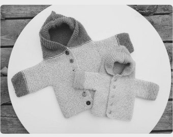 Made to order. Hand knit sweater coat.
