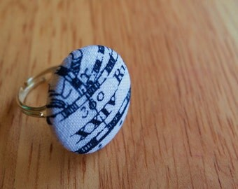 Adjustable ring, with nautical-themed fabric button