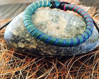 Woven light blue multicolor bracelet