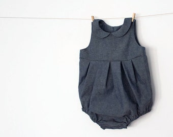 Baby Girl Romper in Chambray – peter pan colar – back and front pleats – mother of pearl buttons