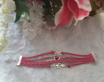 Pink charmed woven braided friendship bracelet.