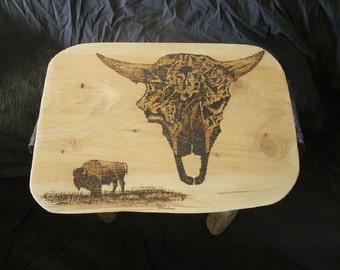 Bison end table with woodburning of bison head and Old authentic buffalo horns on table's sides