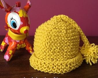 Newborn baby pixie hat. Handknitted in 100% cotton. Beautifully soft. Free postage in Australia.