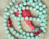 Faceted Aquamarine & Red Glass Mala with Bright Salmon-Peach Tassel and Chalcedony Guru Bead