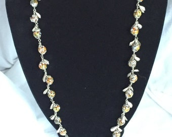 Handcrafted multi colored millefiori bead necklace with silver leaf accents