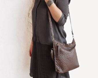 Hand sewn ostrich leather shoulder bag. Ostrich leather bag