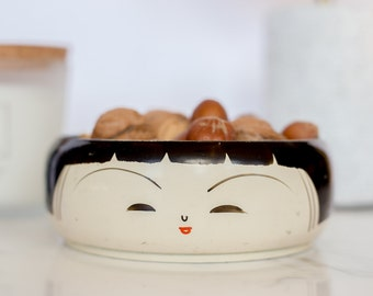 Hand painted lacquered wooden bowl depicting a stylized Geisha