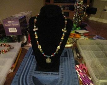 Avant Garde Watch Face Pendant on Beaded Necklace