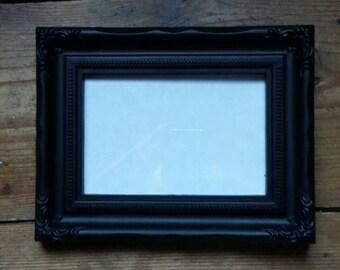 Custom cross stitch in medium frame.