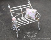 White garden bench with pillow-rose
