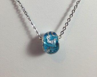 Turquoise blue lamp-worked glass bead on stainless steel