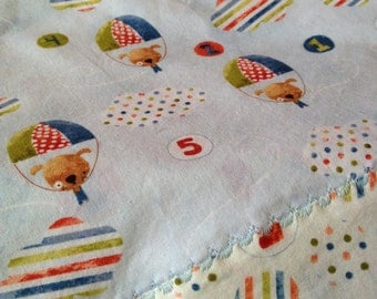 Self binding baby blanket featuring puppies and numbers!