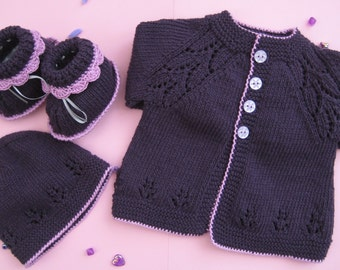 Handmade knitted purple and pink baby girl clothing set, cardigan, booties, hat.