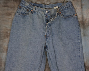 30W x 29L Levis 501 Early 90's - actual measurements are listed. Stock No. 105