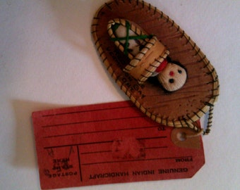 Beaded Papoose doll on birch bark with card