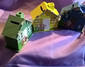 pretty money boxes in green,blue and yellow house shapes