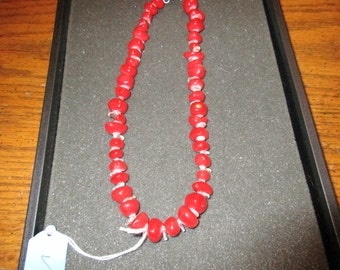 Irregular shaped red and clear beaded necklace.